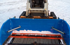 Snowplow easily loads on a trailer .